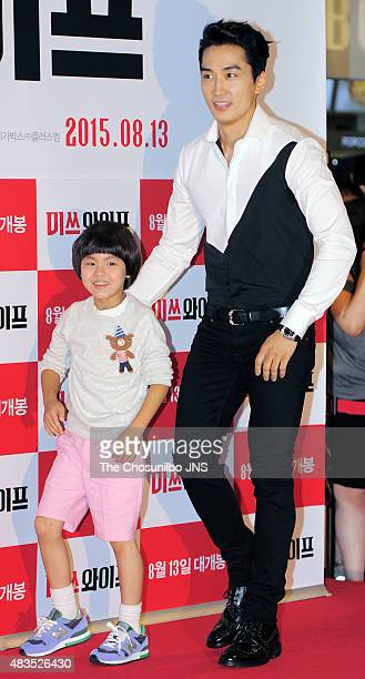 Jeong Ji-Hoon and Song Seung-Heon pose for photographs during the movie 'Wonderful Nightmare' VIP premiere at Megabox on August 5, 2015 in Seoul,...