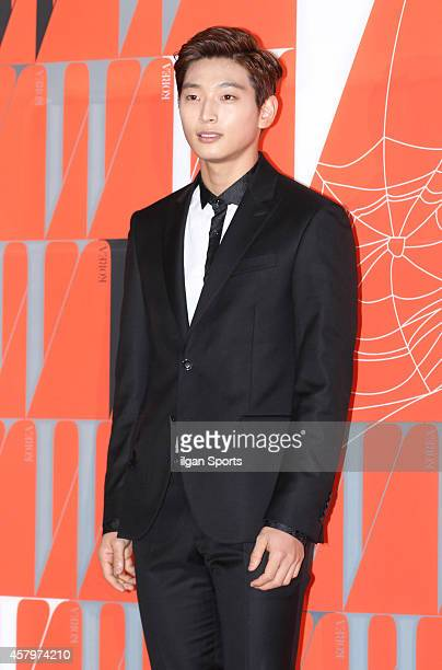 Jeong JinWoon of 2AM poses for photographs during the W Korea campaign Love Your W party at Fradia on October 23 2014 in Seoul South Korea