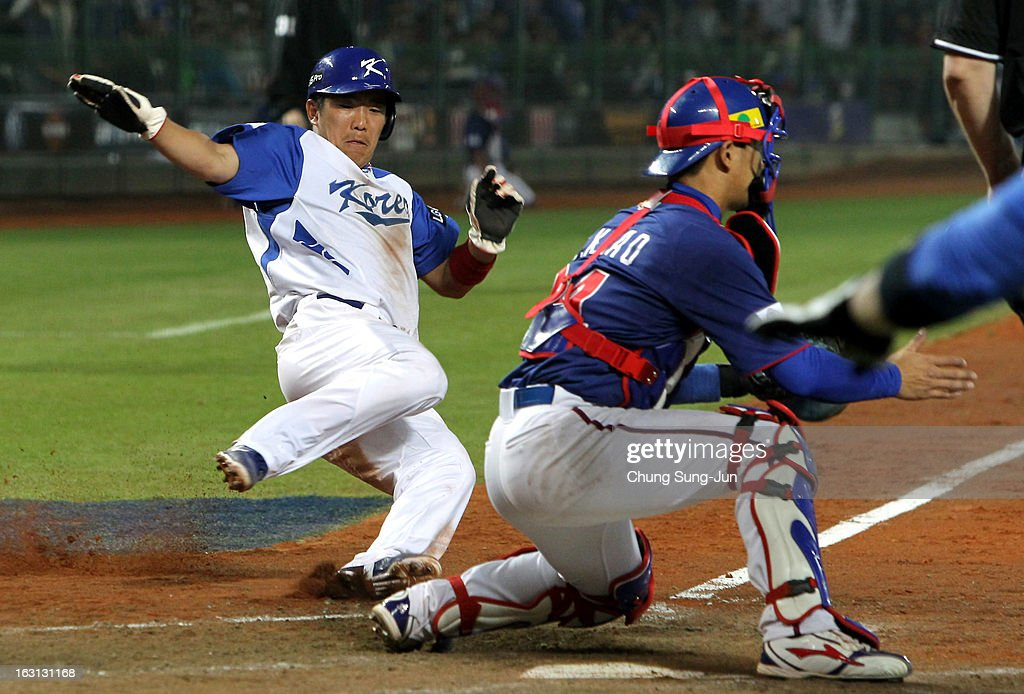 Jeong Keun-Woo of South Korea slides into the home base in the fifth inning during the World Baseball Classic First Round Group B match between Chinese Taipei and South Korea at Intercontinental Baseball Stadium on March 5, 2013 in Taichung, Taiwan.