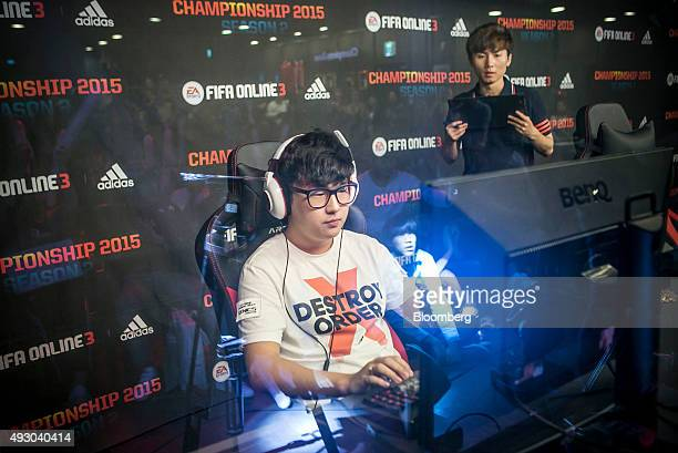 Jeong Se Hyun a professional videogame player competes against Yang Jin Hyeob not pictured during the final round of the Electronic Arts Inc Sports...