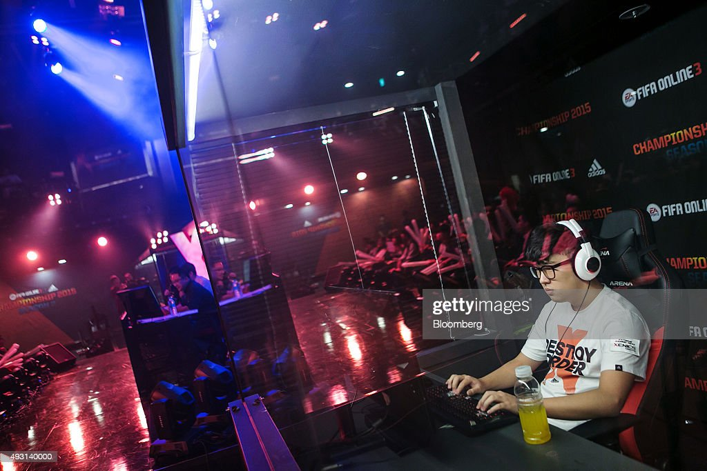 Jeong Se Hyun, a professional video-game player, competes against Yang Jin Hyeob, not pictured, during the final round of the Electronic Arts Inc. (EA) Sports FIFA Online Championship at the Nexon Co. e-Sports Stadium in Seoul, South Korea, on Saturday, Oct. 17, 2015. Video game competitions, known as eSports, have been expanding as gamers seek to shift perceptions around their craft from a basement hobby to a serious money making industry. Photographer: Jean Chung/Bloomberg via Getty Images