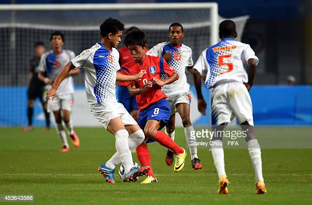 Jeong Wooyeong of Korea Republic competes for the ball during the 2014 Nanjing FIFA Summer Youth Olympic Boy's Football Tournament Preliminary Round...