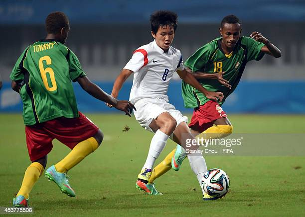 Jeong Wooyeong of Korea Republic competes for the ball during the 2014 FIFA Boys Summer Youth Olympic Football Tournament Preliminary Round Group D...