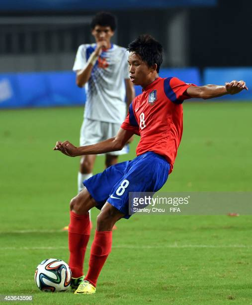 Jeong Wooyeong of Korea Republic scores from the penalty against Cape Verde Island during the 2014 Nanjing FIFA Summer Youth Olympic Boy's Football...