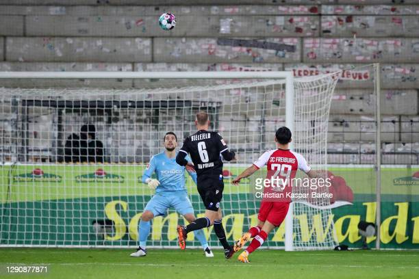Jeong Woo-Yeong of SC Freiburg scores their team's second goal during the Bundesliga match between Sport-Club Freiburg and DSC Arminia Bielefeld at...
