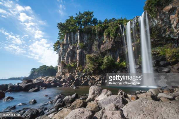 jeongbang waterfall - jeju island stock photos and pictures