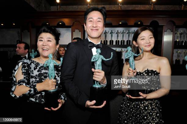 Jeongeun Lee Lee Sun Kyun and Park Sodam winners of Outstanding Performance by a Cast in a Motion Picture for 'Parasite' pose in the trophy room...