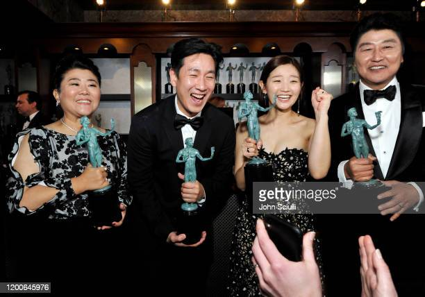 Jeongeun Lee Lee Sun Kyun Park Sodam and Song Kang Ho winners of Outstanding Performance by a Cast in a Motion Picture for 'Parasite' pose in the...