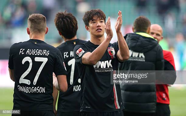 JeongHo Hong of Augsburg applauds the fans after the Bundesliga match between VfL Wolfsburg and FC Augsburg at Volkswagen Arena on April 23 2016 in...