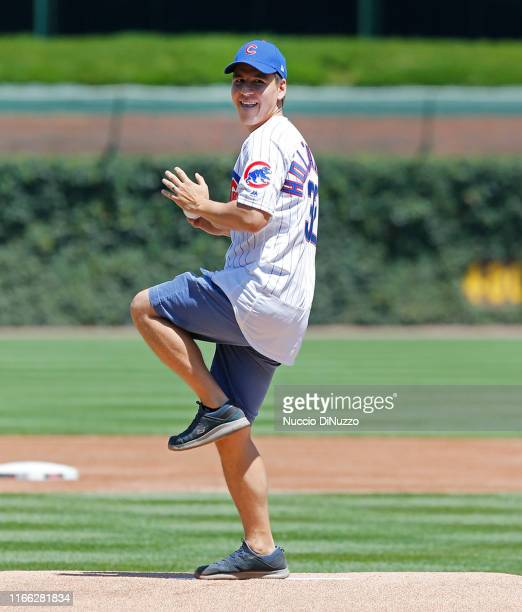 Jeopardy contestant James Holzhauer throws the ceremonial first pitch of the game between the Chicago Cubs and the Milwaukee Brewers at Wrigley Field...
