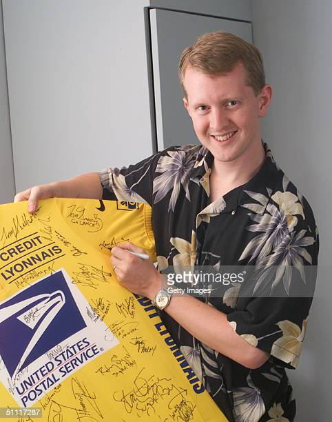 Jeopardy game show champion Ken Jennings signs a yellow Lance Armstrong jersey signed by all the guests who appeared on 'The Tonight Show with Jay...