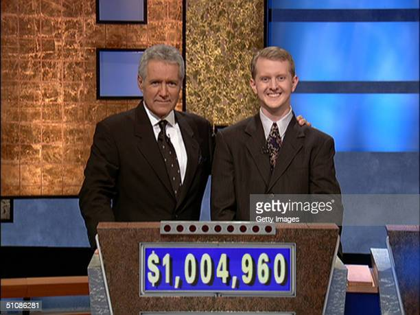 Jeopardy host Alex Trebek poses contestant Ken Jennings after his earnings from his record breaking streak on the gameshow surpassed 1 million...