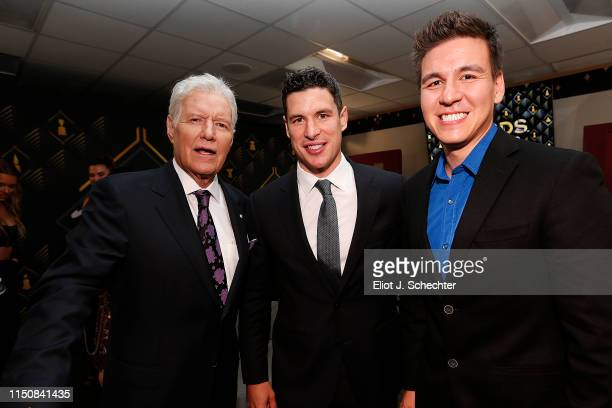 Jeopardy Host Alex Trebek posses with Sidney Crosby of the Pittsburgh Penguins and Jeopardy champion James Holzhauer backstage at the 2019 NHL Awards...