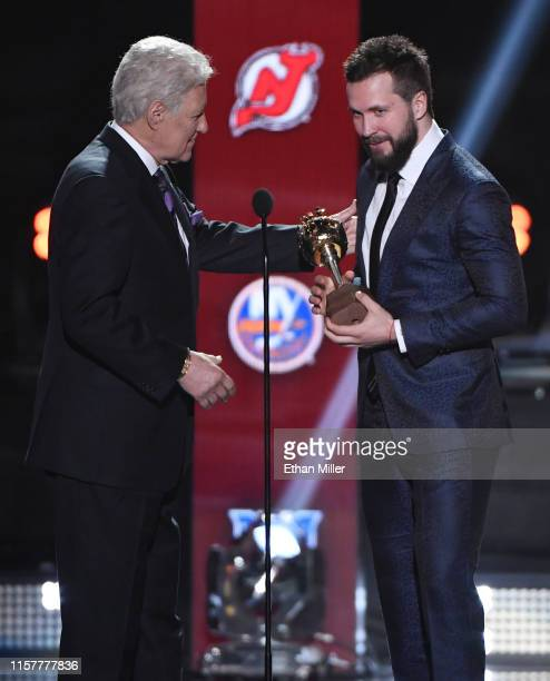 Jeopardy host Alex Trebek presents the Hart Memorial Trophy awarded to the player adjudged to be the most valuable to his team to Nikita Kucherov of...