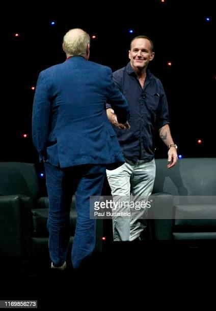 """Jeph Loeb and Clark Gregg speak at Marvel's """"Agents of S.H.I.E.L.D."""" panel during the 2019 D23 Expo at Anaheim Convention Center on August 23, 2019..."""