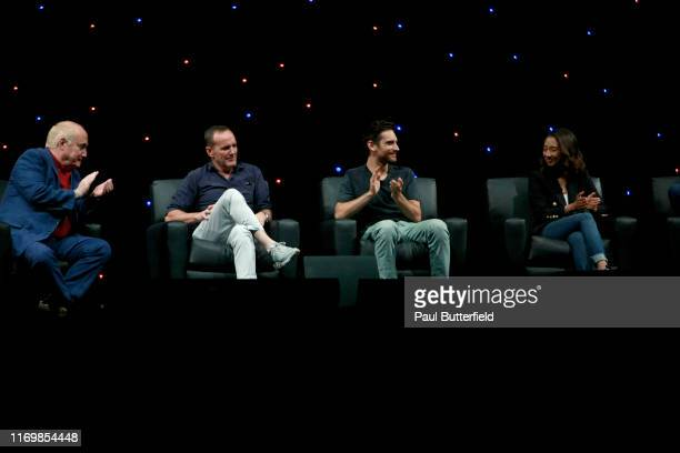 """Jeph Loeb, Clark Gregg, Jeff Ward, and Maurissa Tancharoen speak at Marvel's """"Agents of S.H.I.E.L.D."""" panel during the 2019 D23 Expo at Anaheim..."""
