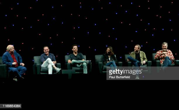 """Jeph Loeb, Clark Gregg, Jeff Ward, Maurissa Tancharoen, Jed Whedon, and Jeff Bell speak at Marvel's """"Agents of S.H.I.E.L.D."""" panel during the 2019..."""