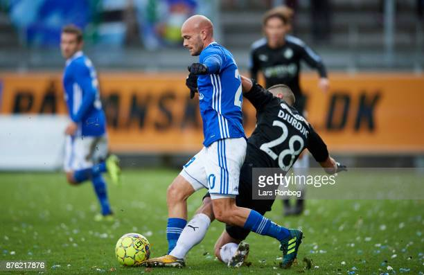Jeppe Brandrup of Lyngby BK and Nikola Djurdjic of Randers FC compete for the ball during the Danish Alka Superliga match between Lyngby BK and...