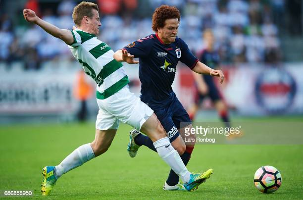Jeppe Curth of Viborg FF and Mustafa Amini of AGF Aarhus compete for the ball during the Danish Alka Superliga match between Viborg FF and AGF Aarhus...