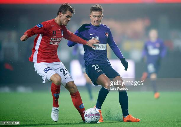 Jeppe Gertsen of Silkeborg IF and Mikkel Duelund of FC Midtjylland compete for the ball during the Danish Alka Superliga match between Silkeborg IF...