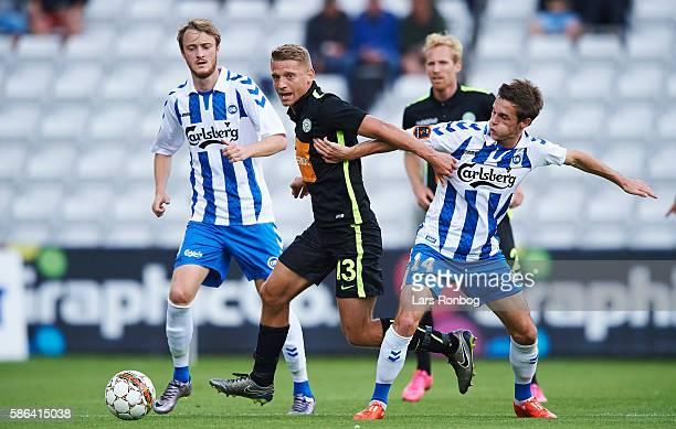 Jeppe Gronning of Viborg FF and Jens Jakob Thomasen of OB Odense compete for the ball during the Danish Alka Superliga match between OB Odense and...