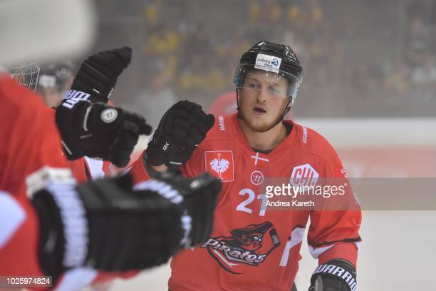 Jeppe Jul Korsgaard of Aalborg Pirates celebrates at the bench after scoring during the Champions Hockey League match between Vienna Capitals and...