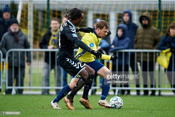 Jeppe Simonsen of SonderjyskE and Simon Tibbling of Brondby IF compete for the ball during the testmatch between Brondby IF and SonderjyskE at...