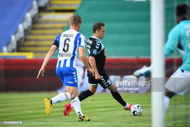 Jeppe Tverskov of OB Odense and Anders K. Jacobsen of SonderjyskE in action during the Danish 3F Superliga match between OB Odense and SonderjyskE at...