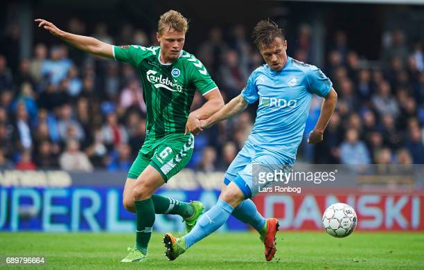 Jeppe Tverskov of OB Odense and Marvin Pourie of Randers FC compete for the ball during the Danish Alka Superliga match between Randers FC and OB...