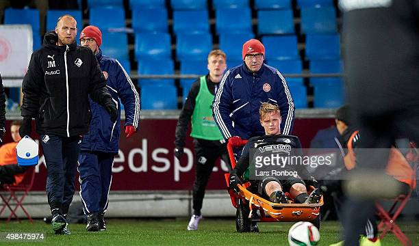 Jeppe Tverskov of Randers FC leaves the pitch injured during the Danish Alka Superliga match between AaB Aalborg and Randers FC at Nordjyske Arena on...
