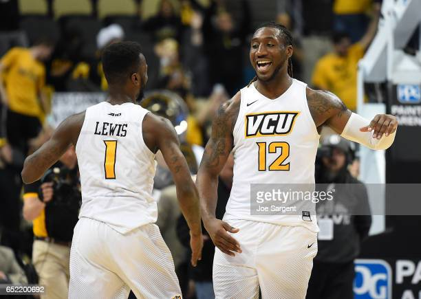 JeQuan Lewis celebrates with Mo AlieCox of the Virginia Commonwealth Rams after a 8777 overtime win over the Richmond Spiders during the semifinals...