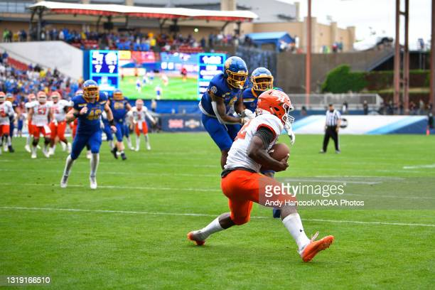 Jequez Ezzard of the Sam Houston State Bearkats catches a touchdown pass over South Dakota State Jackrabbits defenders during the Division I FCS...