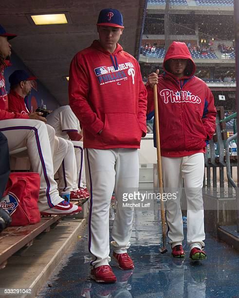 Jerad Eickhoff of the Philadelphia Phillies looks on in the dugout as Vince Velasquez squeegees the water in the top of the seventh inning against...