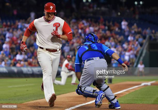 Jerad Eickhoff of the Philadelphia Phillies scores behind Alex Avila of the Chicago Cubs in the second inning at Citizens Bank Park on August 25 2017...