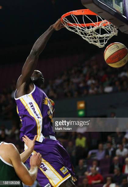 Jerai Grant of the Kings slam dunks the ball during the round seven NBL match between the Sydney Kings and the Cairns Taipans at Sydney Entertainment...