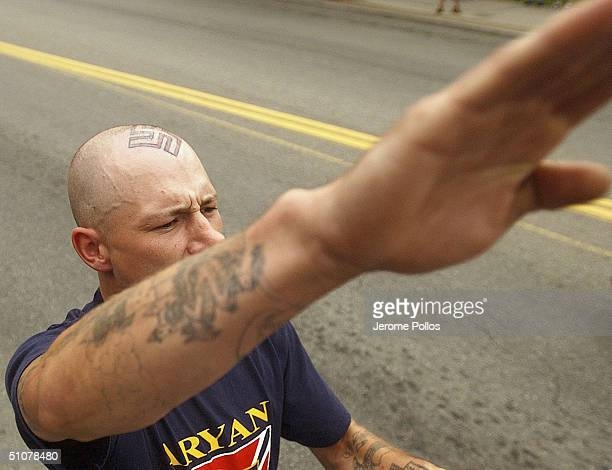 Jerald O'Brien gives a salute during the World Congress Parade held in Coeur d'Alene Idaho on July 17 2004 Around 40 followers of the Aryan Nations...