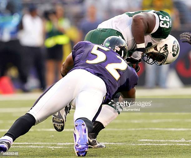 Jerald Sowell of the New York Jets is tackled by Ray Lewis of the Baltimore Ravens on October 2 2005 at MT Bank Stadium in Baltimore Maryland