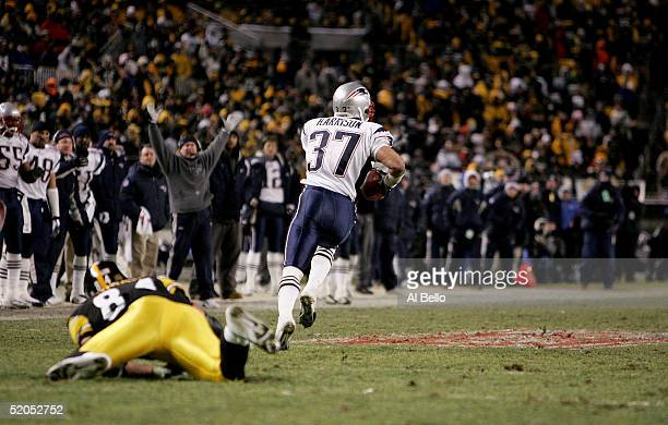 Jerame Tuman of the Pittsburgh Steelers misses a tackle as Rodney Harrison of the New England Patriots returns an interception for a touchdown in the...