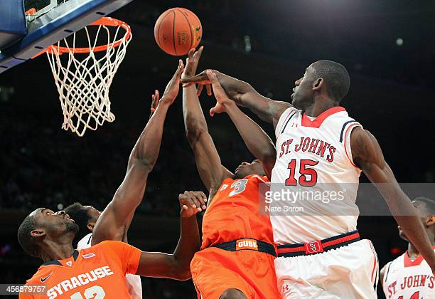 Jerami Grant and Baye Moussa Keita of the Syracuse Orange reach for the rebound against Sir'Dominic Pointer of the St John's Red Storm during the...