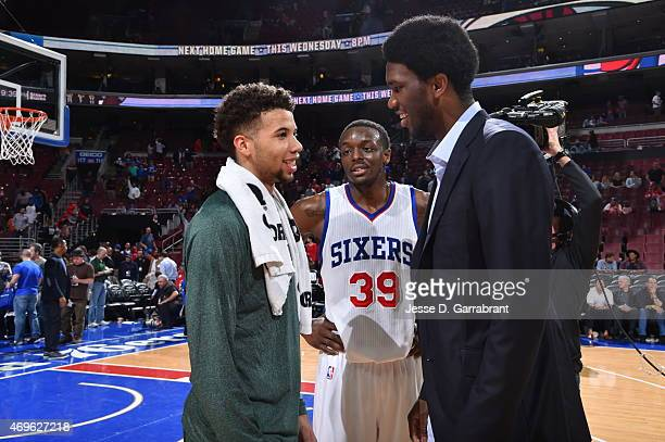 Jerami Grant and Joel Embiid of the Philadelphia 76ers gives Michael CarterWilliams former teammate a hug after the game against the Milwaukee Bucks...