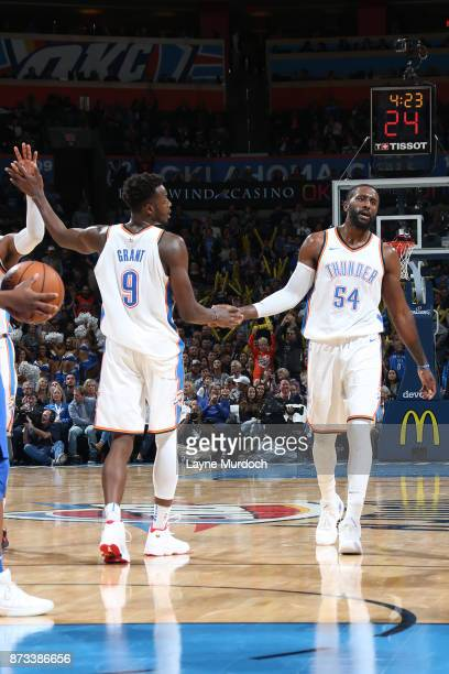 Jerami Grant and Patrick Patterson of the Oklahoma City Thunder high five during the game against the Dallas Mavericks on November 12 2017 at...