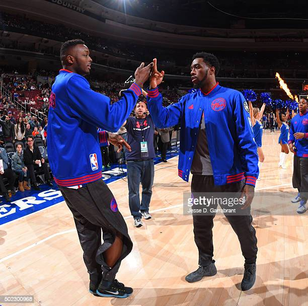 Jerami Grant and Tony Wroten of the Philadelphia 76ers do their own handshake prior to the game against the Memphis Grizzlies at Wells Fargo Center...
