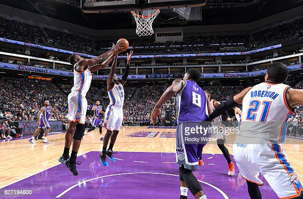 Jerami Grant and Victor Oladipo of the Oklahoma City Thunder rebound against the Sacramento Kings on November 23 2016 at Golden 1 Center in...