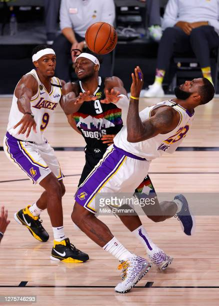 Jerami Grant of the Denver Nuggets passes the ball as LeBron James of the Los Angeles Lakers and Rajon Rondo of the Los Angeles Lakers defend during...