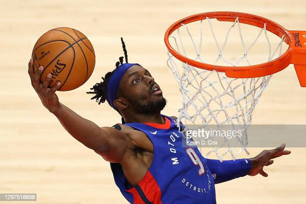 Jerami Grant of the Detroit Pistons dunks an alley-oop against the Atlanta Hawks during the first half at State Farm Arena on January 20, 2021 in...