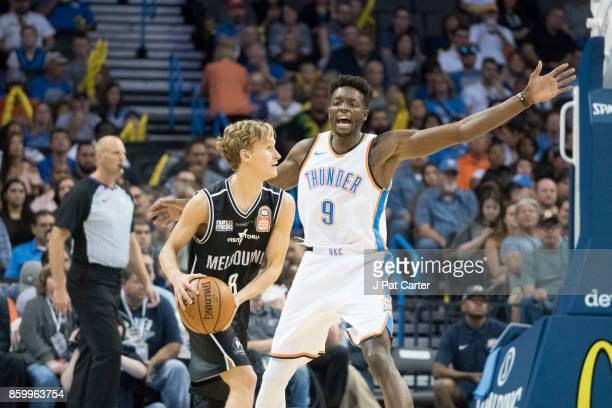 Jerami Grant of the Oklahoma City Thunder blocks Kyle Adnam of the Melbourne United during the first half of a NBA preseason game at the Chesapeake...