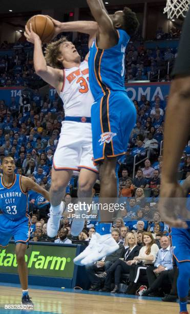 Jerami Grant of the Oklahoma City Thunder blocks Ron Baker of the New York Knicks during the second half of a NBA game at the Chesapeake Energy Arena...