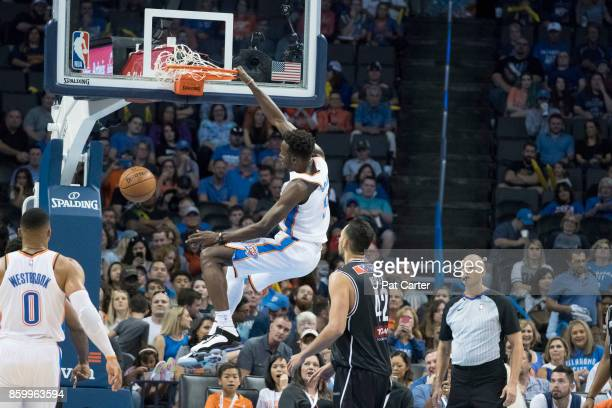 Jerami Grant of the Oklahoma City Thunder dunks two points against Melbourne United during the second half of a NBA preseason game at the Chesapeake...