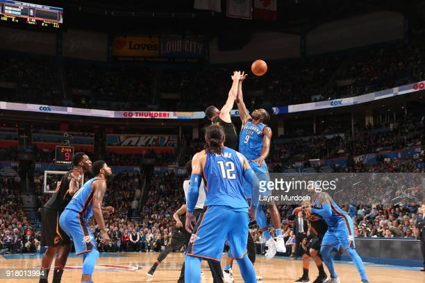 Jerami Grant of the Oklahoma City Thunder goes for the jump ball against the Cleveland Cavaliers on February 13 2018 at Chesapeake Energy Arena in...