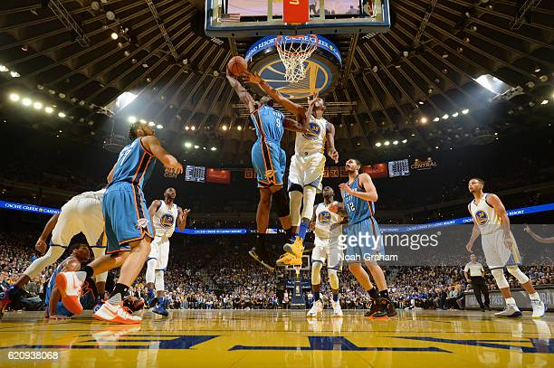 Jerami Grant of the Oklahoma City Thunder goes up for a dunk against Kevin Durant of the Golden State Warriors during a game on November 3 2016 at...